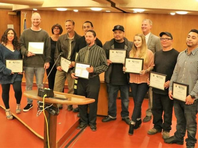 Chief Mike Daly pictured here with Wall of Change graduates from Marin County Probation